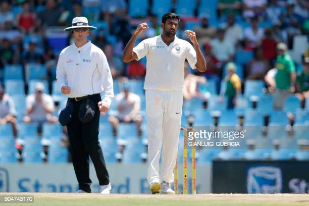 Indian bowler Ravichandran Ashwin reacts as South African batsmen take runs during the second day of the second Test cricket match between South...