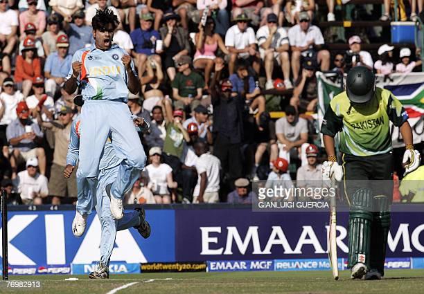 Indian bowler RP Singh celebrates 24 September 2007 the dismissal of Pakistan batsman Kamran Akmal during the Twenty20 cricket world championship...