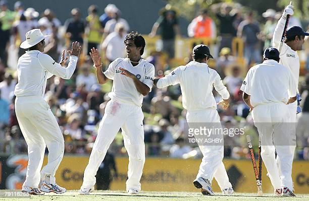 Indian bowler RP Singh joins his teamates in jubilation after the team won the third Test against Australia by 72 runs on the fourth day at the WACA...