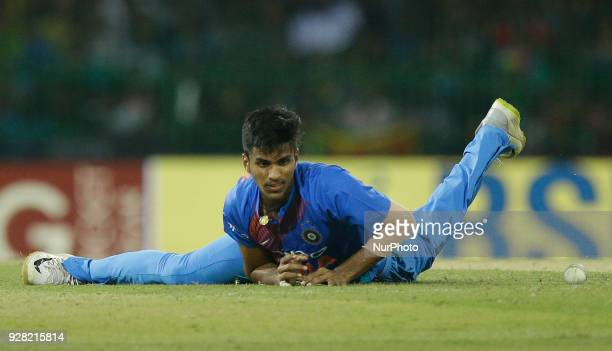 Indian bowler Washington Sundar fails to collect the ball during the 1st T20 cricket match of NIDAHAS Trophy between Sri Lanka and India at R...