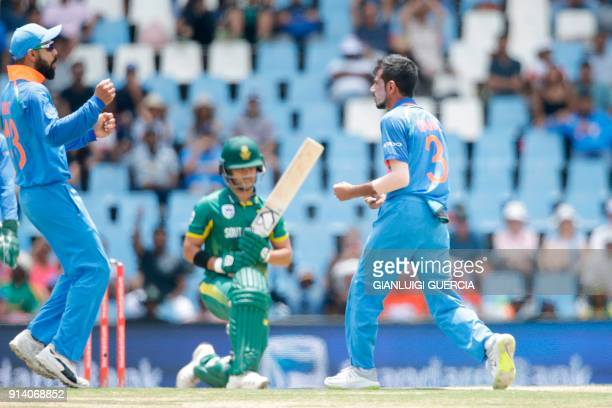 Indian bowler Yuzvendra Chahal celebrates the dismissal of outh African batsman JP Duminy during the second One Day International cricket match...
