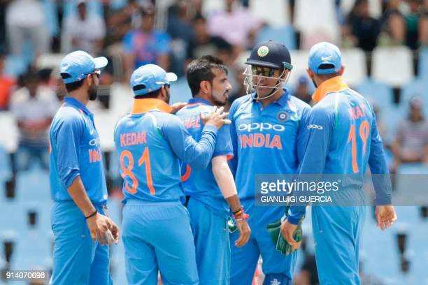 Indian bowler Yuzvendra Chahal celebrates the dismissal South African batsman JP Duminy during the second One Day International cricket match between...