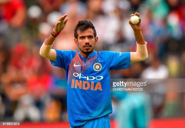 Indian bowler Yuzvendra Chahal gestures as he sets his field during the first T20I cricket match between South Africa and India at The Wanderers...