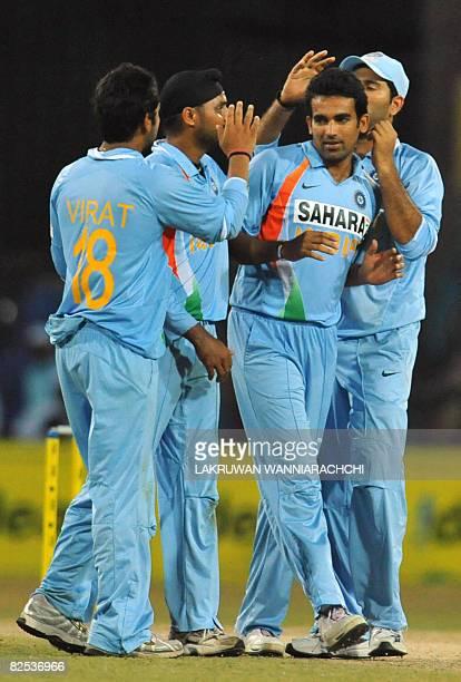 Indian bowler Zaheer Kahn celebrates with teammates after the dismissal of Sri Lankan batsman Thilina Thushara Mirando during the third One Day...