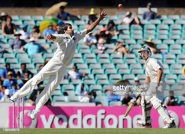 Indian bowler Zaheer Khan leaps to try and catch out Australian batsman Ricky Ponting as Ed Cowan returns to his crease during the second cricket...