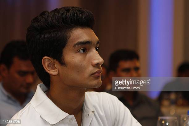 Indian boxer Shiva Thapa who has qualified for the London 2012 Olympics attends a press conference arranged by the Indian Amateur Boxing Federation...