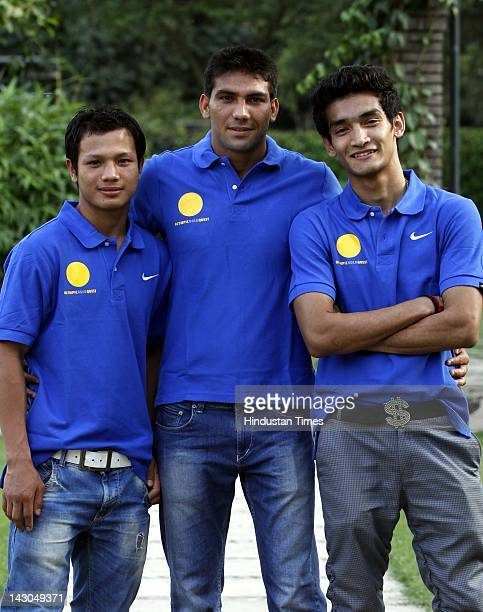 Indian boxers Devandro Singh Manoj Kumar and Shiv Thapa during an British sports festival series function for 100 days countdown London Olympics on...