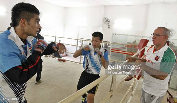 Indian Boxers L Devendro Singh and Shiva Thapa practicing at Karnail Singh Stadium on June 28 2013 in New Delhi India The 10member boxing team will...