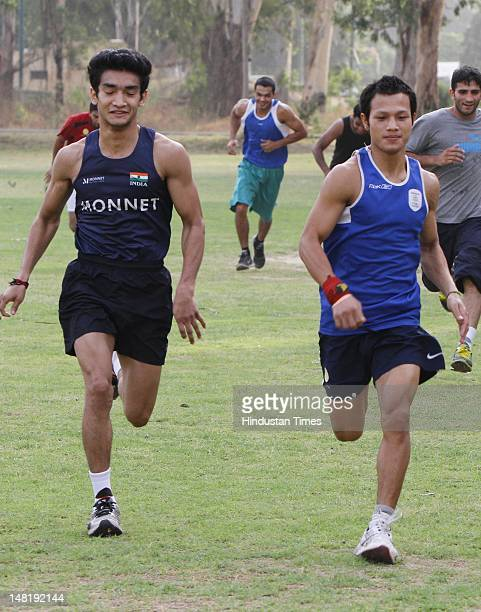 Indian Boxers Shiva Thapa and L Devendro Singh during training on June 28 2012 at NIS Patiala India This time record 8 pugilists will be representing...