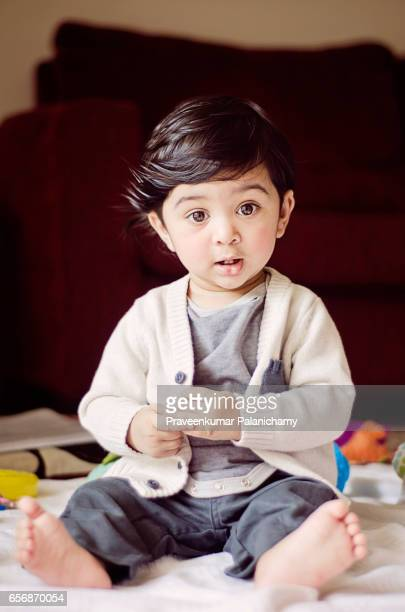indian boy child playing - asian baby stock photos and pictures