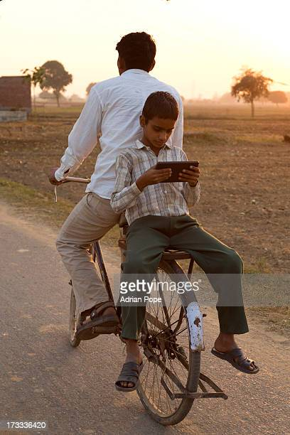 Indian boy reading tablet device