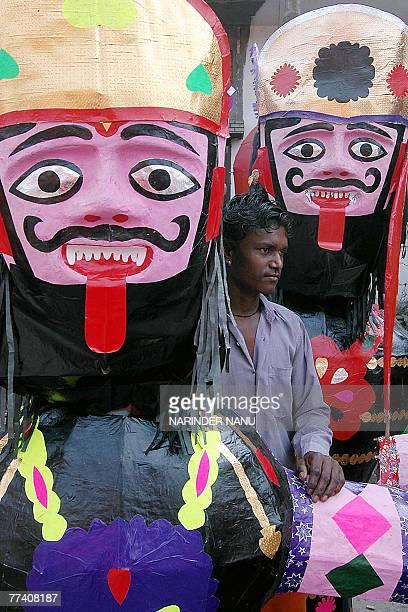 Indian boy Sanpath sells effigies of the Hindu demon King Ravana on the road side in Amritsar 19 October 2007 for the upcoming Hindu festival of...