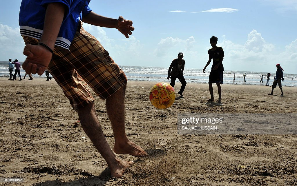 Indian boys play football at Juhu beach in Mumbai on June 6, 2010. AFP PHOTO/Sajjad HUSSAIN