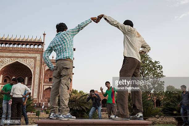 Indian boys pose for a photograph as they visit the Taj Mahal on May 29 2013 in Agra India Completed in 1643 the mausoleum was built by the Mughal...