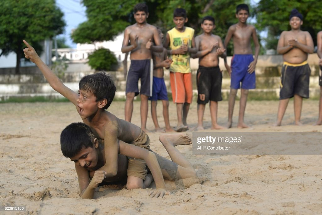 Indian boys practice `Kushti` at a village near Jalandhar on July 28 2017 Kushti traditional wrestling is popular across the subcontinent and was...