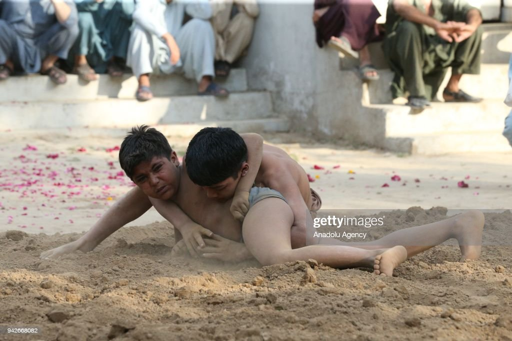 Indian boys practice `Kushti` at Liaqat Bagh in Rawalpindi Pakistan on April 6 2018 Kushti is a traditional wrestling sport that is common in India...