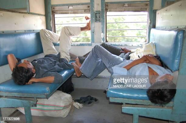 Indian boys sleeping deeply in a train
