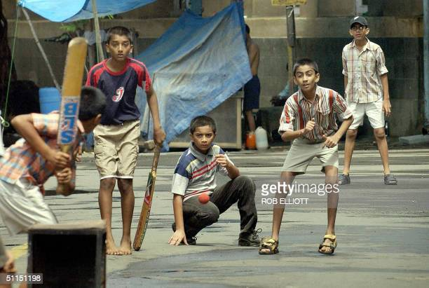 Indian boys using only a fruit box as stumps play cricket in a back street of Bombay 08 August 2004 Cricket continues to enthral people of all ages...