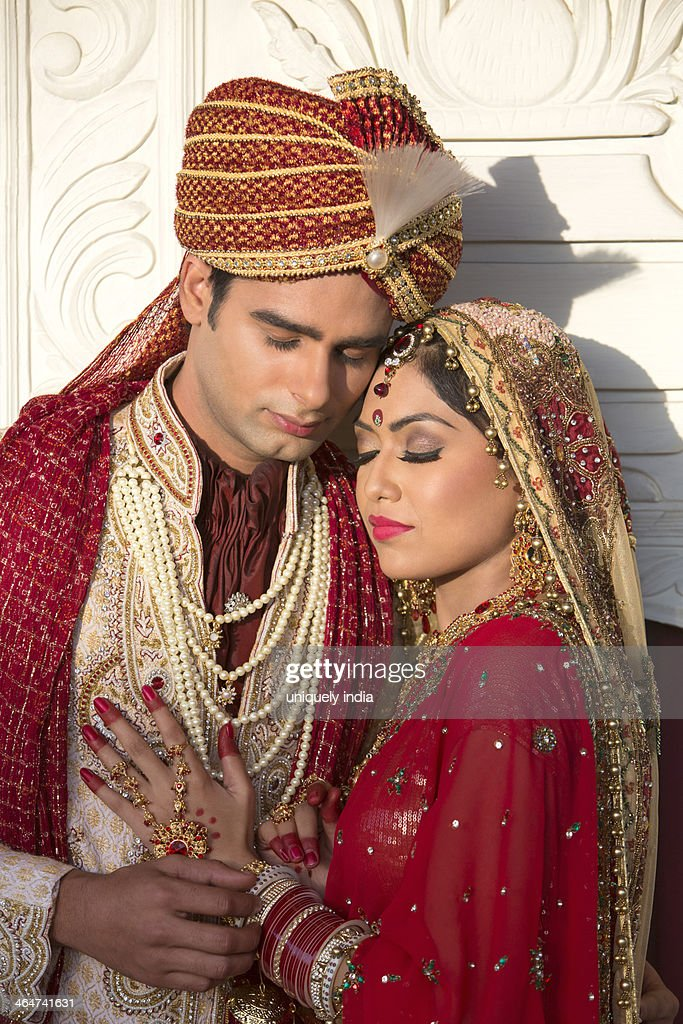 Indian Bride And Groom In Traditional Wedding Dress And Hugging ...