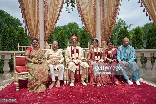 indian bride and groom with family in traditional clothing - punjab india stock pictures, royalty-free photos & images