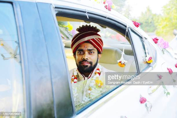 indian bride groom in car - indian culture stock pictures, royalty-free photos & images