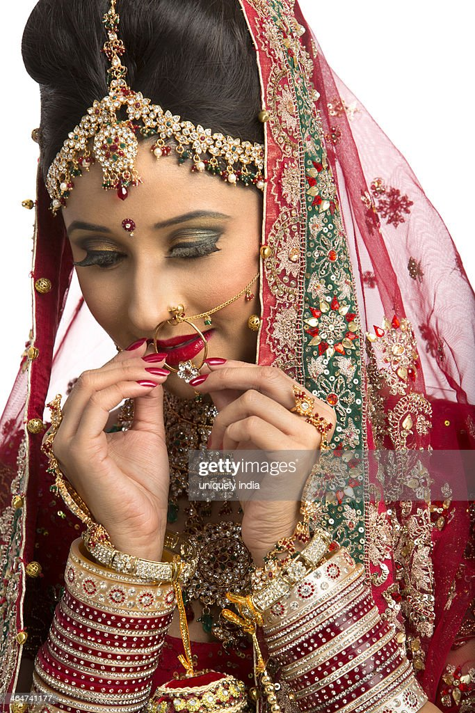Indian Bride In Traditional Wedding Dress Adjusting Her Nose Ring