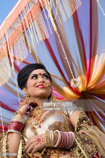 Indian bride in traditional wedding dress in mandap