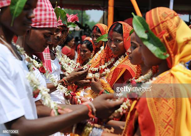 Indian brides and grooms from the Adivasi tribe take part in a mass marriage ceremony during a religious conference in Salbari village on the...