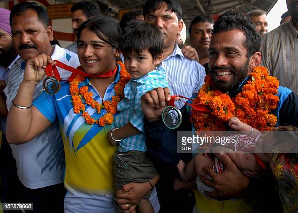 Indian bronze medalist and Punjab Armed Police constable Rajwinder Kaur and silver medalist Assistant Sub Inspector Navjot Singh Chana pose for a...
