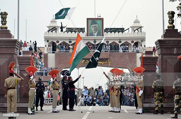 Indian BSF and Pakistani rangers soldier during beating the retreat ceremony at AttariWagah international border a day after suicide attack on...