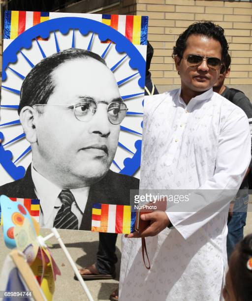 Indian Buddhist man holds a large poster of Dr Bhimrao Ramji Ambedkar during the festival of Vesak in Mississauga Ontario Canada on 28 May 2017 Vesak...