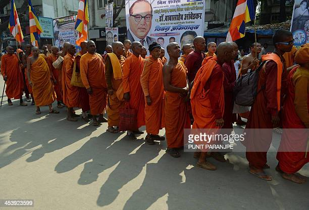 Indian Buddhist monks participate in a procession near the historic Chaitya Bhoomi memorial on BR Ambedkar's 57th death anniversary in Mumbai on...