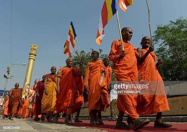 Indian Buddhist monks walk during a procession at the historic Chaitya Bhoomi memorial on BR Ambedkar's 57th death anniversary in Mumbai on December...