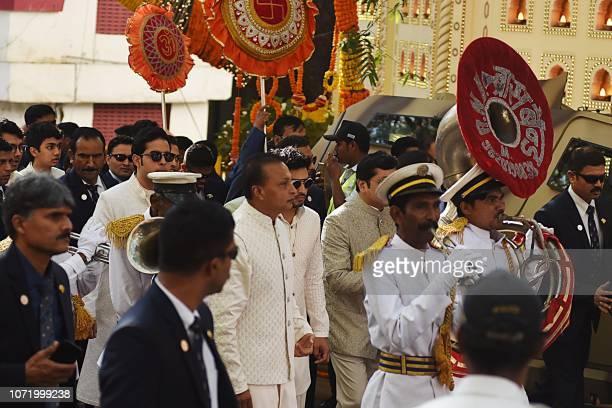 Indian businessman Amil Ambani arrives with the marriage procession of Indian businessman Mukesh Ambani's daughter Isha Ambani outside their house in...