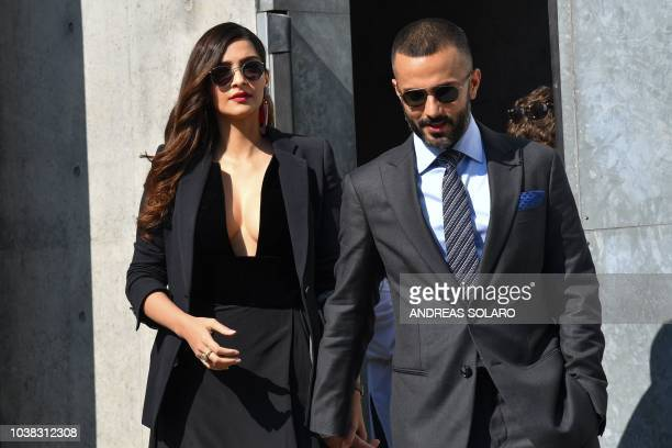 Indian businessman Anand Ahuja and Indian actress Sonam Kapoor arrive to pose for photographers after attending the Armani fashion show as part of...