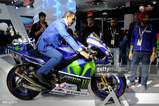 Indian businessman and the husband of politician Priyanka Vadra, Robert Vadra poses with Yamaha Movistar YZR-M1 MotoGP model at the Auto Expo 2016 on...