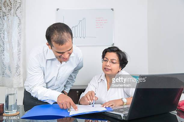 Indian Businessman discussing and explaining things to a colleague.