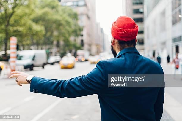 Indian businessman hailing a taxi in Manhattan
