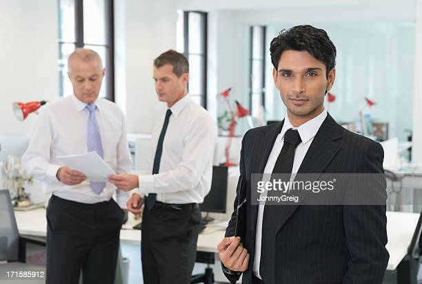 Indian Businessman in Front of colleagues
