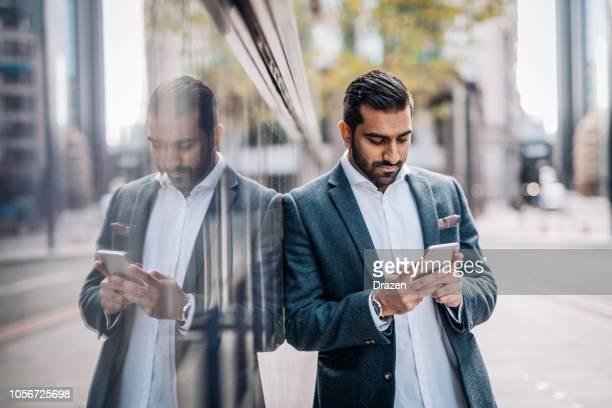 indian businessman in the united kingdom - one man only stock pictures, royalty-free photos & images
