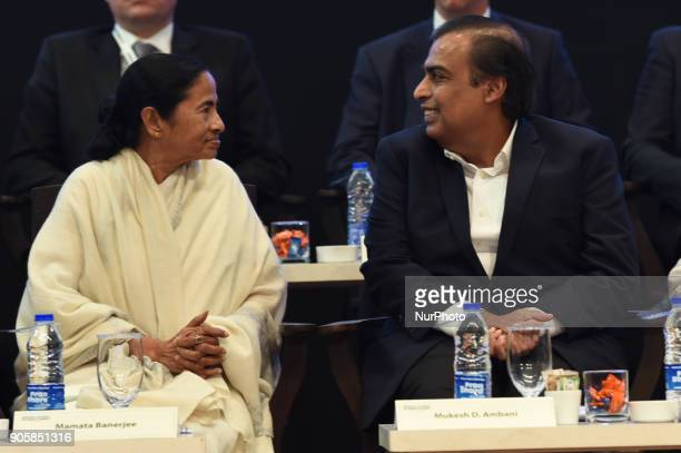 Indian businessman Mukesh Ambani and chief minister of the eastern Indian state of West Bengal Mamata Banerjee at the start of the Bengal Global...