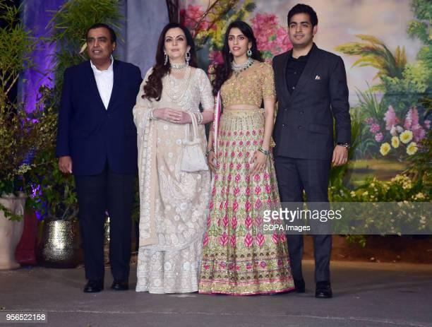 Indian businessman Mukesh Ambani with wife Nita Ambani Shloka Mehta and Akash Ambani attend the wedding reception of actress Sonam Kapoor and Anand...