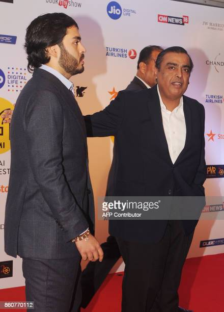 Indian businessman Mukesh Dhirubhai Ambani with his son Anant Ambani attend the opening ceremony of the Jio MAMI 19th Mumbai Film Festival in Mumbai...