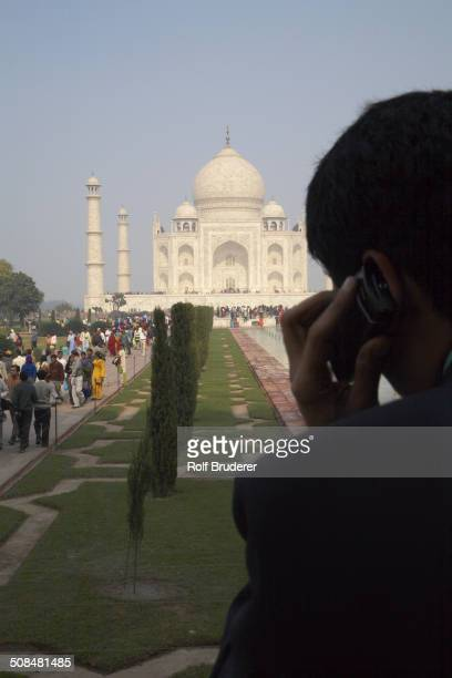 Indian businessman on cell phone by Taj Mahal, Agra, India