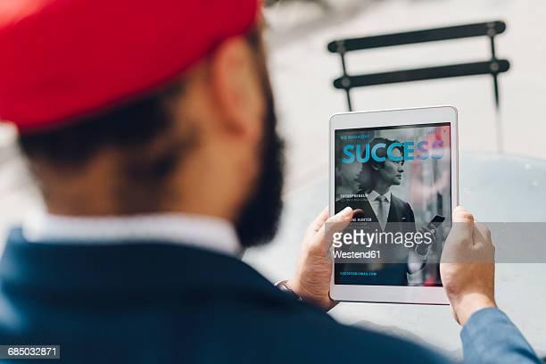 indian businessman sitting in manhattan, using digital tablet - manhattan magazine stock photos and pictures