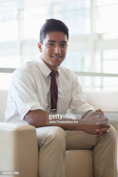 Indian businessman smiling in office lobby