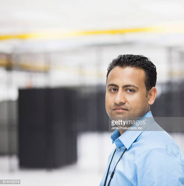 Indian businessman standing in server room