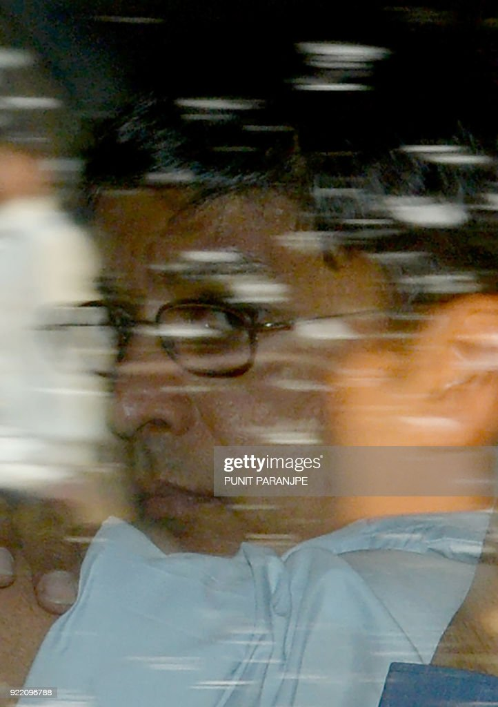 Indian businessman Vipul Ambani, one of the accused in the Punjab National Bank (PNB) fraud case, accused in the Punjab National Bank (PNB) fraud case is escorted after his appearance in the special CBI court in Mumbai on February 21, 2018. India's federal police have arrested six people, including employees of a billionaire jeweller, as an inquiry into one of the country's biggest bank scams widens, investigators said on February 21. /