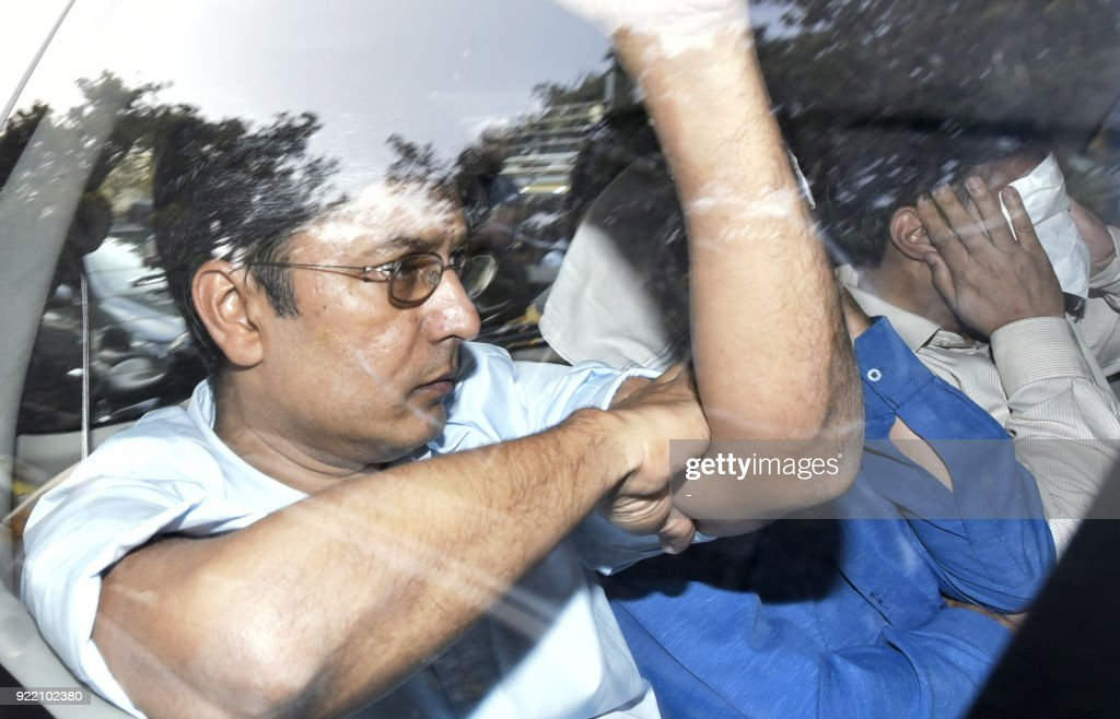 Indian businessman Vipul Ambani one of the accused in the Punjab National Bank fraud case accused in the Punjab National Bank fraud case is escorted..