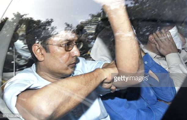 Indian businessman Vipul Ambani one of the accused in the Punjab National Bank fraud case accused in the Punjab National Bank fraud case is escorted...